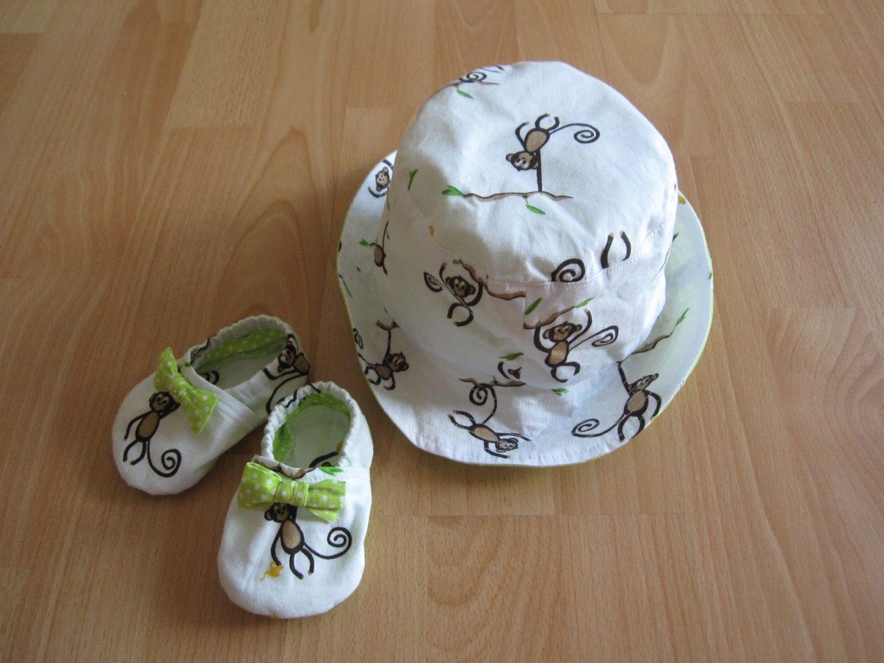 Baby Schuhe und Sommerhut